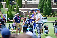 Jordan Spieth (USA) and caddie, Michael Greller hydrate on the 8th tee during Saturday's round 3 of the PGA Championship at the Quail Hollow Club in Charlotte, North Carolina. 8/12/2017.<br /> Picture: Golffile | Ken Murray<br /> <br /> <br /> All photo usage must carry mandatory copyright credit (&copy; Golffile | Ken Murray)