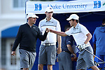DURHAM, NC - SEPTEMBER 16: Liberty's Alexandre Fuchs (FRA) with head coach Jeff Thomas and assistant coach Andrew Nelson (center) on the first tee. The first round of the Rod Myers Invitational Men's Golf Tournament was held on September 16, 2017, at the Duke University Golf Club in Durham, NC.