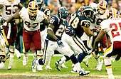 Landover, Maryland - November 27, 2005 -- San Diego Chargers running back LaDainian Tomlinson (21) breaks through the line en-route to his game-winning touchdown in overtime against the Washington Redskins at FedEx Field in Landover, Maryland on November 27, 2005.  The final score was Chargers 23 - Redskins 17..Credit: Ron Sachs / CNP