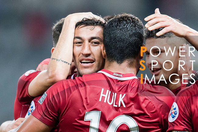 Shanghai FC Midfielder Akhmedov Odil (L) celebrating his score with his teammates during the AFC Champions League 2017 Round of 16 match between Shanghai SIPG FC (CHN) vs Jiangsu FC (CHN) at the Shanghai Stadium on 24 May 2017 in Shanghai, China. Photo by Marcio Rodrigo Machado / Power Sport Images