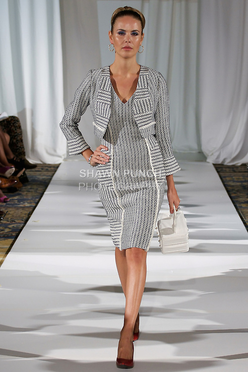 Jenia walks runway in a navy/white graphic print in double-faced silk cotton bolero and sheath, from the b Michael AMERICA Couture Spring 2013 collection during Mercedes-Benz Fashion Week Spring 2013, at the Jumeirah Essex House on September 12, 2012.