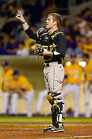 Catcher Mike Lubanski #10 of the Wake Forest Demon Deacons lets his defense know how many outs there are against the LSU Tigers at Alex Box Stadium on February 18, 2011 in Baton Rouge, Louisiana.  The Tigers defeated the Demon Deacons 15-4.  Photo by Brian Westerholt / Four Seam Images