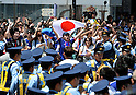 June 15, 2014, Tokyo, Japan - A huge crowd of hard-core soccer fans stage a pep rally in front of Tokyos Shibuya railroad station following Japans 1-2 loss to Ivory Coast in a world cup match on Sunday, June 15, 2014. The west African handed Japan her first defeat in their first match in the preliminary round of the 2014 FIFA World Cup in Recife, Brazil. (Photo by Natsuki Sakai/AFLO