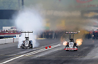Sept. 2, 2013; Clermont, IN, USA: NHRA top fuel dragster driver Steve Torrence (right) races alongside Tommy Johnson Jr during the US Nationals at Lucas Oil Raceway. Mandatory Credit: Mark J. Rebilas-