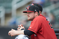 Kannapolis Intimidators coach Ryan Johansen (21) watches the action from the dugout during the game against the Rome Braves at Kannapolis Intimidators Stadium on April 7, 2019 in Kannapolis, North Carolina. The Intimidators defeated the Braves 2-1. (Brian Westerholt/Four Seam Images)