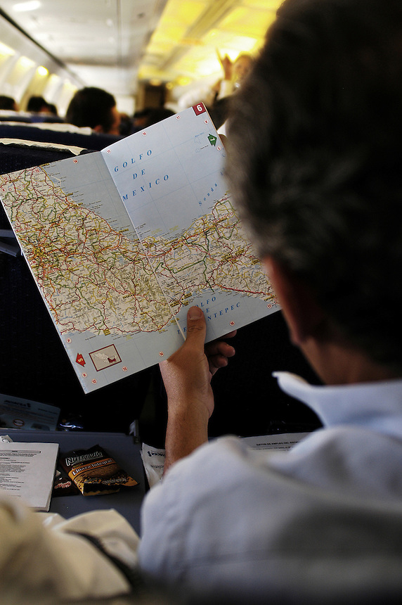 Felipe Calderon studies the map of southwestern Mexico on his way to Tapachula, his first stop on the campaign trail in the state of Chiapas. Calderon is surging ahead in the run for the presidency of Mexico as the PAN candidate. Thursday