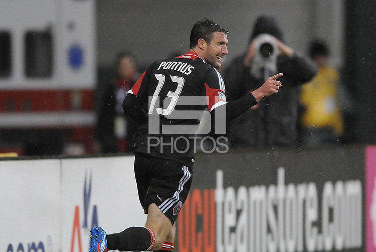 D.C. United midfielder Chris Pontius (13) celebrates his third goal in the 69th minute of the game. D.C. United defeated The New York Red Bulls 4-1 at RFK Stadium, Sunday April 22, 2012.