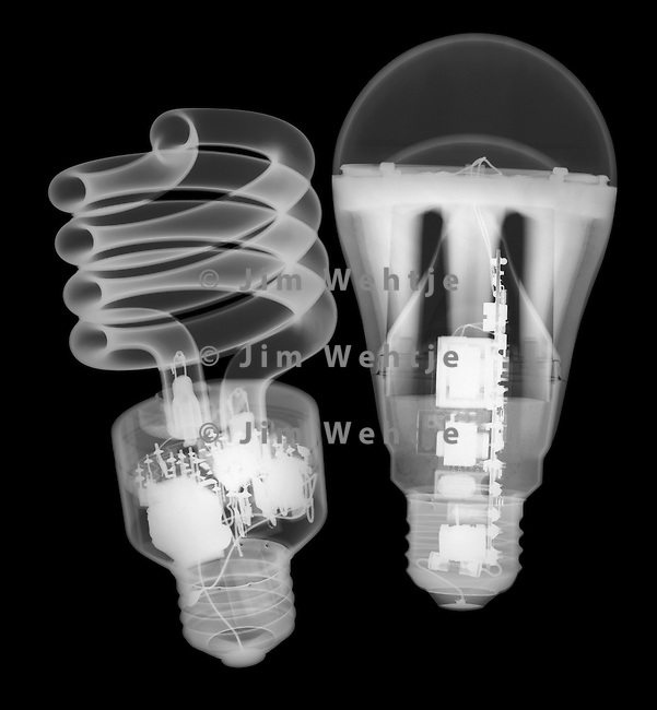 X-ray image of CFL and LED bulbs (white on black) by Jim Wehtje, specialist in x-ray art and design images.
