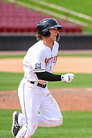 Wisconsin Timber Rattlers outfielder Zach Clark (7) races to first base during a Midwest League game against the Lansing Lugnuts on May 8, 2018 at Fox Cities Stadium in Appleton, Wisconsin. Lansing defeated Wisconsin 11-4. (Brad Krause/Four Seam Images)