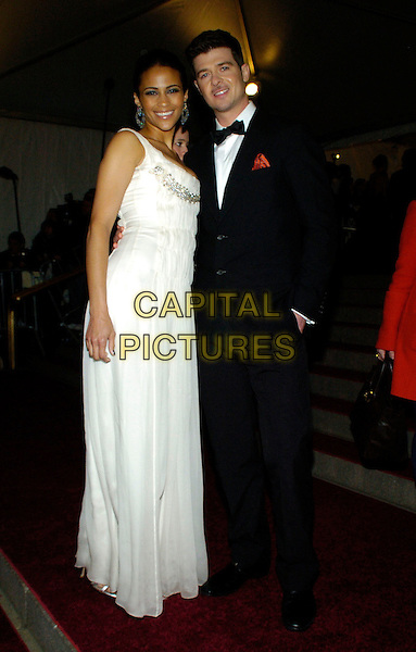 "PAULA PATTON & ROBIN THICKE .2007 Metropolitan Museum of Art Costume Institute Gala celebrating ""Poiret: King of Fashion"" exibition at the Metropolitan Museum of Art, New York City, New York, USA..May 7th, 2007.full length white dress black dinner suit tuxedo .CAP/ADM/BL.©Bill Lyons/AdMedia/Capital Pictures *** Local Caption ***"