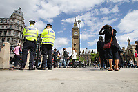 People cross Westminster Bridge with Big Ben  Tower and the Houses of Parliament in the background in London,England on June 9, 2017 after results in a snap general election show a hung parliament with Labour gains and the loss of the Conservative majority. British Prime Minister Theresa May faced pressure to resign on Friday after losing her parliamentary majority, plunging the country into uncertainty as Brexit talks loom. The pound fell sharply amid fears the Conservative leader will be unable to form a government and could even be forced out of office after a troubled campaign overshadowed by two terror attacks.
