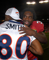 Aug. 31, 2006; Glendale, AZ, USA; Arizona Cardinals running back (32) Edgerrin James greets Denver Broncos wide receiver (80) Rod Smith following the game at Cardinals Stadium in Glendale, AZ. Mandatory Credit: Mark J. Rebilas