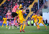 Lincoln City's Jason Shackell vies for possession with Northampton Town's Aaron Pierre, centre, and Northampton Town's Ash Taylor<br /> <br /> Photographer Chris Vaughan/CameraSport<br /> <br /> The EFL Sky Bet League Two - Lincoln City v Northampton Town - Saturday 9th February 2019 - Sincil Bank - Lincoln<br /> <br /> World Copyright &copy; 2019 CameraSport. All rights reserved. 43 Linden Ave. Countesthorpe. Leicester. England. LE8 5PG - Tel: +44 (0) 116 277 4147 - admin@camerasport.com - www.camerasport.com