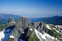"Aerial View of ""The Lions"" Mountain Peaks (Coast Mountains) and ""Unnecessary Ridge"", near Vancouver (on horizon), BC, British Columbia, Canada, Spring"