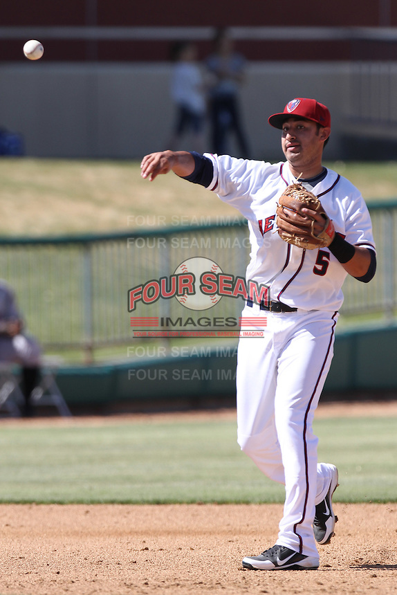 Jio Mier #5 of the Lancaster JetHawks throughs to first base during a game against the Lake Elsinore Storm at Clear Channel Stadium on April 15, 2012 in Lancaster,California. Lake Elsinore defeated Lancaster 7-5.(Larry Goren/Four Seam Images)