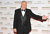 Washington, DC - December 5, 2009 -- Mel Brooks, one of the 2009 Kennedy Center honorees, motions to his family as he arrives for the formal Artist's Dinner at the United States Department of State in Washington, D.C. on Saturday, December 5, 2009..Credit: Ron Sachs / CNP.(RESTRICTION: NO New York or New Jersey Newspapers or newspapers within a 75 mile radius of New York City)