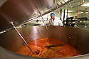 "19/06/16<br /> <br /> Pasquale Tanzarella , Director,  oversees mixing of vat of Tasty Orange ice lolly mix.<br /> <br /> ""The last couple of days have sent the factory into meltdown,"" exclaimed Pasquale Tanzarella, director of one of the UK's largest independent ice-lolly manufacturers.<br /> <br /> In fact, today alone, his factory will make more than 200,000 ice lollies, which will be sold up and down the country through traditional ice-cream vans and shops. <br /> <br /> Demand has been so high because of the recent hot spell that the cold rooms at Franco's ices, in Kempston, Bedfordshire, are already full to bursting, with more than 40 different varieties of ice-cream and ice-lollies, and today's production of Tasty Orange lollies will probably be on sale by late afternoon.<br /> <br /> The lollies start life in a huge 2,000-litre vat, as a syrupy, bright orange liquid, before being poured into the traditional ice-lolly moulds.<br /> <br /> From there they are passed over a fast-freezer, at around -36C, to super cool the liquid into ice, which only takes around 20 minutes, before being loaded into their colourful outer wrapper.<br /> <br /> And then it's straight into wholesale boxes, stored in the factory's cold rooms, and sold the very same day.<br /> <br /> It's a super success story for this family-run business, which was founded in1964 by Pasquale's father, Domenico Tanzarella, originally to sell ice-creams through a local chain of vans.<br /> <br /> ""In the 70s we used to only supply vans within about a 60-mile radius of the factory,"" said Pasquale.<br /> <br /> ""But we've grown steadily over the years and now we export to Cyprus, Ireland and even South Africa, as well as being one of the biggest suppliers here in the UK.<br /> <br /> ""Our best seller by far is the Mr Bubble ice-lolly,"" said Pasquale. ""We were the very first company to launch a bubble gum flavoured lolly and it's been our best seller ever since.""<br /> <br /> Last year they sold more than five million of the bright blue treat and if this current heatwave continues you can be sure the company will"