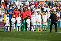 Ashley Crowden takes a picture of the children mascots during the Sky Bet Championship match between Swansea City and Rotherham United at the Liberty Stadium, Swansea, Wales, UK. Friday 19 April 2019