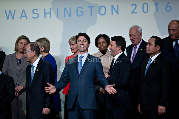 Justin Trudeau, Canada's prime minister, center, gestures as he walks out of a family photo at the Nuclear Security Summit in Washington, D.C., U.S., on Friday, April 1, 2016. After a spate of terrorist attacks from Europe to Africa, U.S. President Barack Obama is rallying international support during the summit for an effort to keep Islamic State and similar groups from obtaining nuclear material and other weapons of mass destruction. <br /> Credit: Andrew Harrer / Pool via CNP/MediaPunch