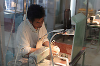 Beijing ,China- 2007 File Photo -<br /> <br /> <br /> Worker of a Jade factory.<br /> <br /> <br /> photo : James Wong-  Images Distribution
