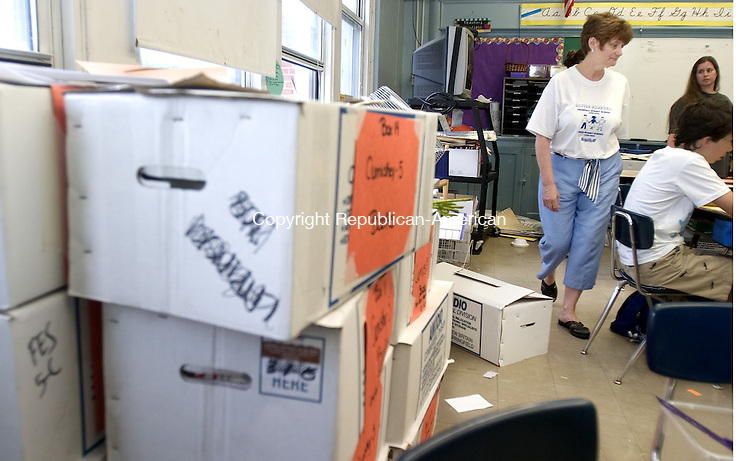 PLYMOUTH, CT. 16 June 2008-061608SV03--At right, 5th grade teacher Judy Cumiskey works with students while packing up her room at Main Street School in Terryville Monday. The students and teachers will be relocating to the Fisher School next year.<br /> Steven Valenti Republican-American