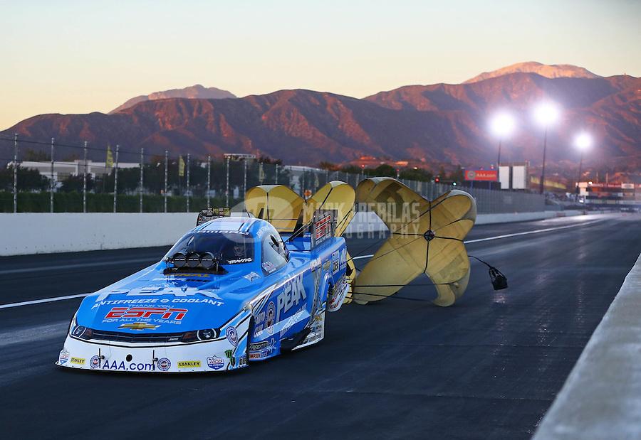 Nov 13, 2015; Pomona, CA, USA; NHRA funny car driver John Force during qualifying for the Auto Club Finals at Auto Club Raceway at Pomona. Mandatory Credit: Mark J. Rebilas-USA TODAY Sports