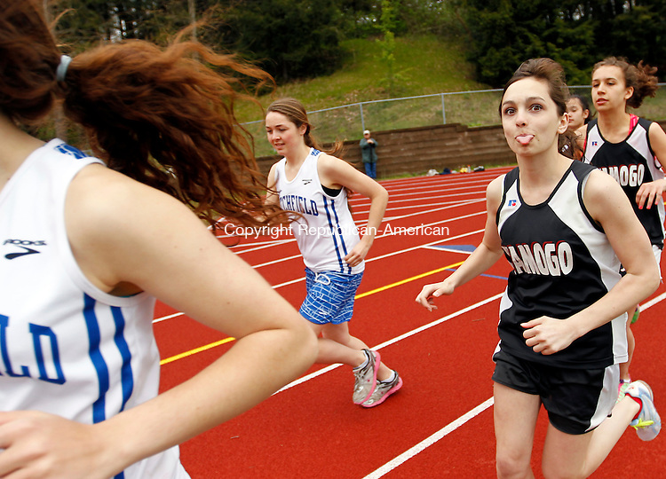 Woodbury, CT-01 May 2012-050112CM05- A Wamogo runner has some fun and sticks out her tongue at the start of the 1600m Tuesday afternoon at Nonnewaug High School in Woodbury. Bridget Nicholas of Nonnewaug was the  winner of the race.    Christopher Massa Republican-American