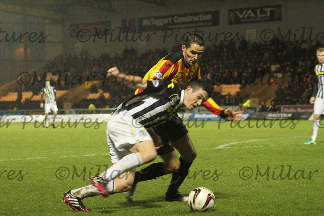 John McGinn being pressured by Lee Mair in the St Mirren v Partick Thistle Scottish Professional Football League Premiership match played at St Mirren Park, Paisley on 25.1.14.