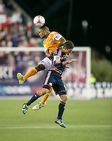 Houston Dynamo midfielder Ricardo Clark (13) and New England Revolution defender Chris Tierney (8) leap for a head ball.  The New England Revolution played to a 1-1 draw against the Houston Dynamo during a Major League Soccer (MLS) match at Gillette Stadium in Foxborough, MA on September 28, 2013.