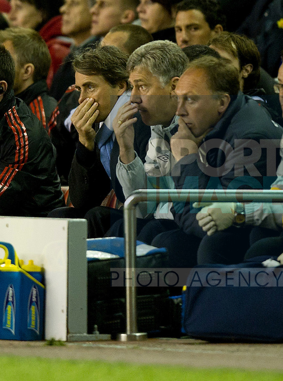 Roberto Mancini manager of Manchester City witth his assistants look dejected