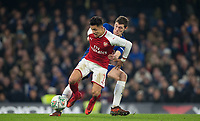 Alexis Sanchez of Arsenal & Andreas Christensen of Chelsea during the Carabao Cup semi final 1st leg match between Chelsea and Arsenal at Stamford Bridge, London, England on 10 January 2018. Photo by Andy Rowland.