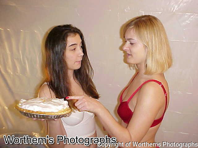 A different models, your classic brunette versus a blonde with the brunette holding a pie.