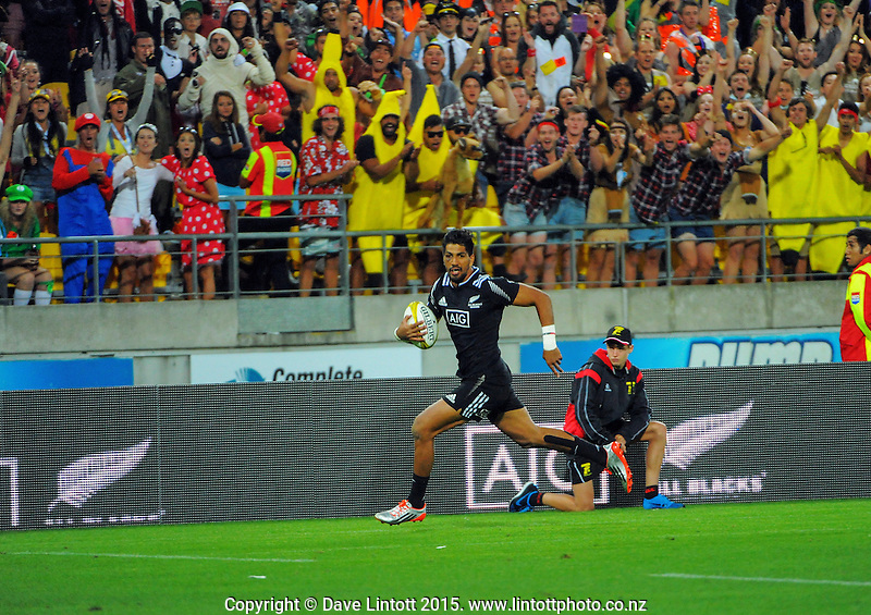 NZ's Dylan Collier scores the opening try in the Cup Final against England on day two of the 2015 HSBC Sevens World Series Wellington Sevens at Westpac Stadium, Wellington, New Zealand on Saturday, 7 February 2015. Photo: Dave Lintott / lintottphoto.co.nz