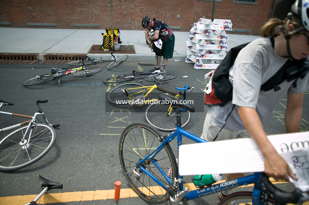 3 July 2005 - Jersey City, NJ, USA - Riders leave a checkpoint with parcels they must delilver at another checkpoint in the final race of the 13th annual cycle messenger world championships, Jersey City, USA, July 2nd 2005. More than 700 riders from all over the world took part in the 4-day competition which carries event based on the daily work of a city bike messenger.