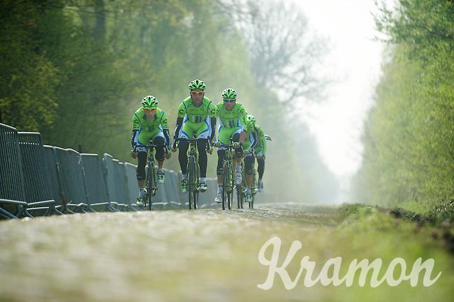 Team Cannondale trying to follow Peter Sagan (SVK/Cannondale) up ahead at sector 18: Pavé de la Trouée d'Arenberg<br /> <br /> <br /> 2014 Paris-Roubaix reconnaissance