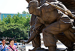 Visitors pass by the national war memorial at the War Museum in Seoul, South Korea on 23 June, 2010..