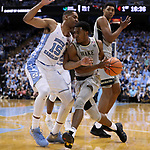 CHAPEL HILL, NC - DECEMBER 30: Wake Forest's Bryant Crawford (13) and North Carolina's Garrison Brooks (15). The University of North Carolina Tar Heels hosted the Wake Forest University Demon Deacons on December 30, 2017 at Dean E. Smith Center in Chapel Hill, NC in a Division I men's college basketball game. UNC won the game 73-69.