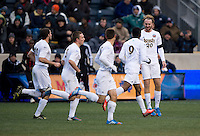 Leon Brown (9) of Notre Dame  celebrates his goal with teammate Grant De Castelle (20) during the NCAA Men's College Cup final at PPL Park in Chester, PA.  Notre Dame defeated Maryland, 2-1.
