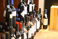 Wine shop. Wine bottles with tied neck labels. Lisbon, Portugal