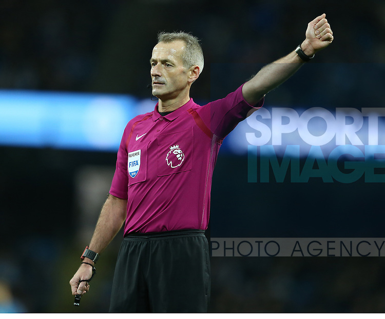Referee Martin Atkinson during the English Premier League match at the Etihad Stadium, Manchester. Picture date: December 18th, 2016. Picture credit should read: Simon Bellis/Sportimage