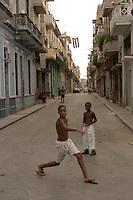 boys in street scene in Havana, Cuba