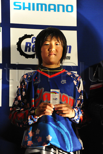 05.27.2012. England, Birmingham, National Indoor Arena. UCI BMX World Championships. Asuma Nakai (Japan) on the podium receiving 4th prize for the Cruisers Boys 12 and under Finals at the NIA ....