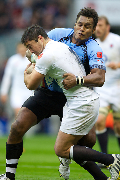 Brad Barritt of England is tackled by Sireli Naqelevuki of the Flying Fijians during the QBE International between England and Fiji at Twickenham on Saturday 10th November 2012 (Photo by Rob Munro)