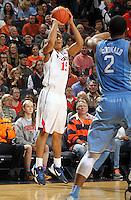 Virginia guard Malcolm Brogdon (15) shoots the ball during an NCAA basketball game Monday Jan. 20, 2014 in Charlottesville, VA. Virginia defeated North Carolina 76-61.