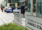 October 27, 2017, Tokyo, Japan -  People admire vehicles of Japanese automaker Subaru at the company headquarters in Tokyo on Friday, October 27, 2017. Subaru president Yasuyuki Yoshinaga apologizes as the company has been carrying out flawed inspections of their vehicles.    (Photo by Yoshio Tsunoda/AFLO) LWX -ytd-