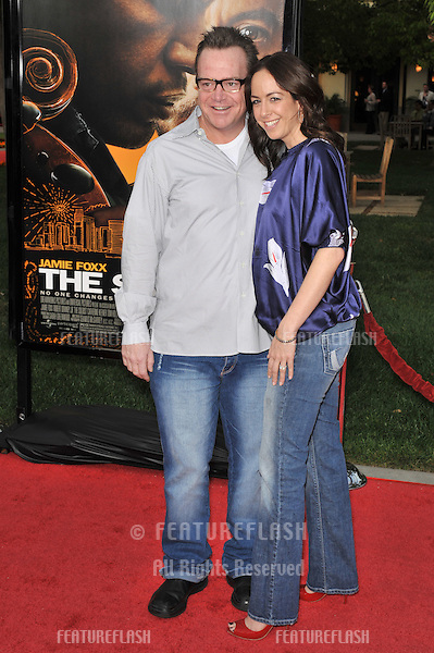 Tom Arnold & date at the Los Angeles premiere of The Soloist at Paramount Theatre, Hollywood. .April 20, 2009  Los Angeles, CA.Picture: Paul Smith / Featureflash