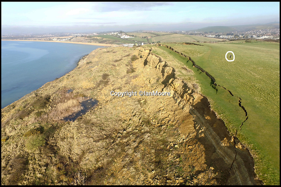 BNPS.co.uk (0202 558833)<br /> Pic: IanMoore/BNPS<br /> <br /> Amateur drone pilot Ian Moore is circled to show the scale of the landslip.<br /> <br /> Birds eye view of Jurassic crack...<br /> <br /> These stunning aerial images show the dramatic extent of a huge land movement that has changed the face of Britain's Jurassic Coast.<br /> <br /> The 300 yard long crack opened up in the cliffs at Bowleaze cove near Weymouth, Dorset, after thousands of tons of earth suddenly gave way.<br />  <br /> Ian Moore flew a camera drone over the seaside beauty spot to inspect the scale of the landslip from above.