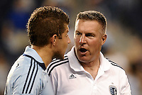 Peter Vermes Head Coach (white) Sporting KC talking with Luke Sassano... Sporting Kansas City defeated Real Salt Lake 2-0 at LIVESTRONG Sporting Park, Kansas City, Kansas.
