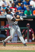 Oregon State outfielder Dylan Davis (10) swings the bat during Game 11 of the 2013 Men's College World Series against the Mississippi State Bulldogs on June 21, 2013 at TD Ameritrade Park in Omaha, Nebraska. The Bulldogs defeated the Beavers 4-1, to reach the CWS Final and eliminating Oregon State from the tournament. (Andrew Woolley/Four Seam Images)