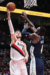 Portland Trail Blazers center Jusuf Nurkic (27) shoots over Denver Nuggets forward Paul Millsap (4) in the second half at Moda Center. <br /> Photo by Jaime Valdez